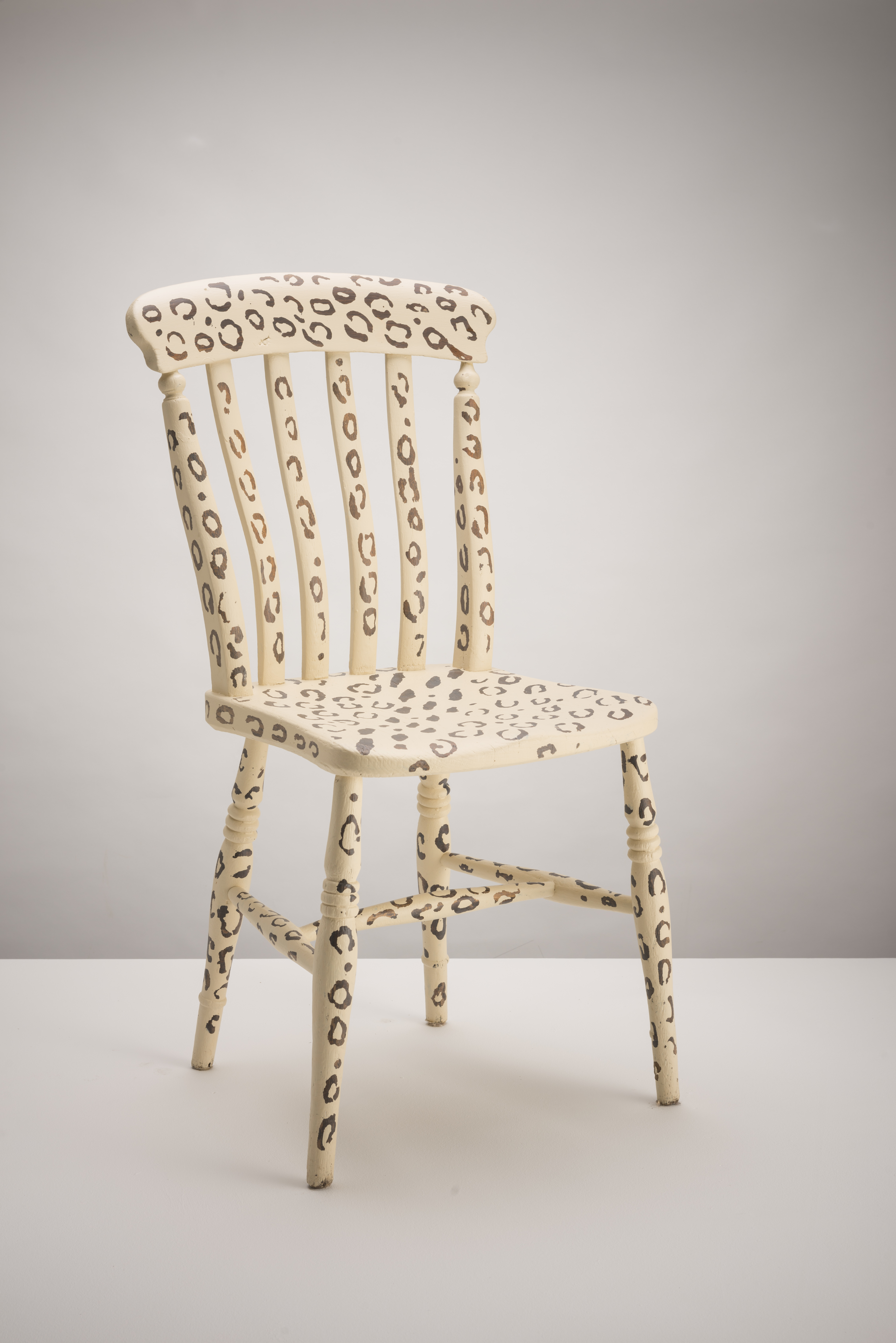 Example Leopard Print Wooden Chair. The print is the original wood underneath.